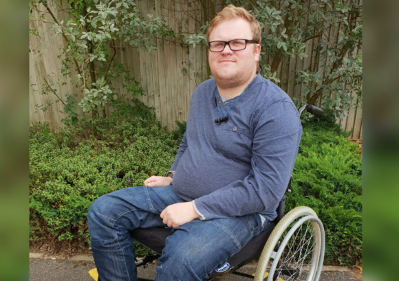 Callum, who back uo helped return to work after spinal cord injury, outside