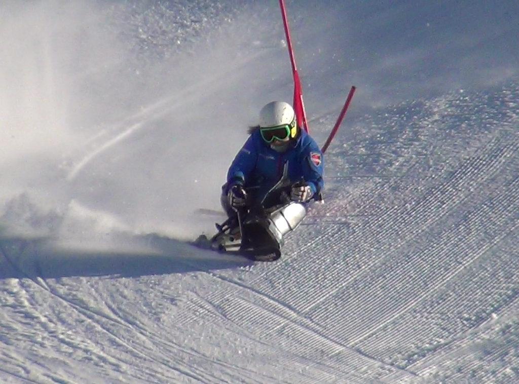 Anna sit skiing around a red pole