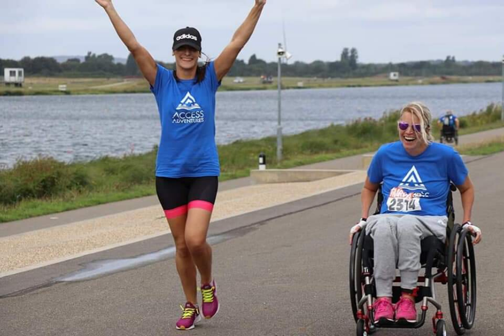 Melissa pushing a race with her personal assistant