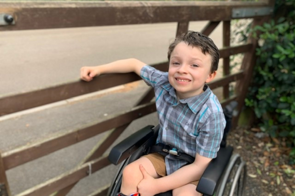 Emerson, a young wheelchair user, spending some time outside. BBC Children in Need worked with us to tell his story.
