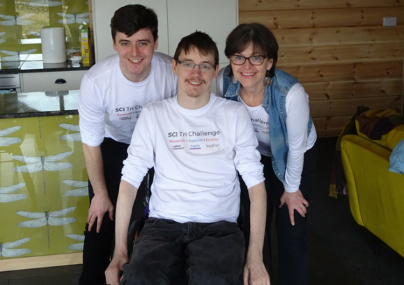 Sam, Sarah and Andrew smiling while wearing their SCI Tri Challenge t-shirts