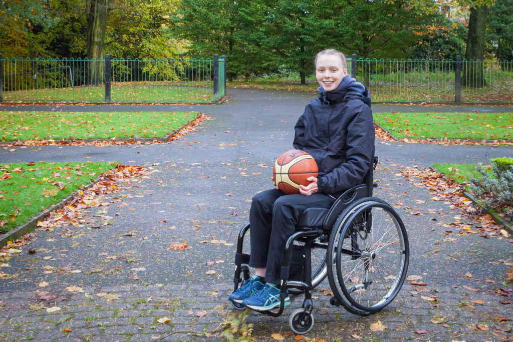 Hannah, a young person with a spinal cord injury we interviewed for our impact report