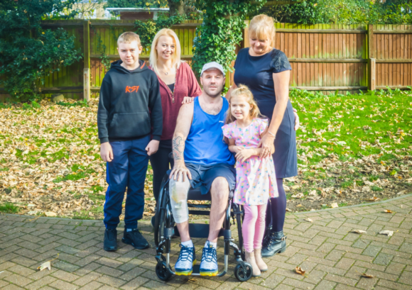 Lorraine with her son Christopher who we supported after spinal cord injury. read our impact report to hear their story
