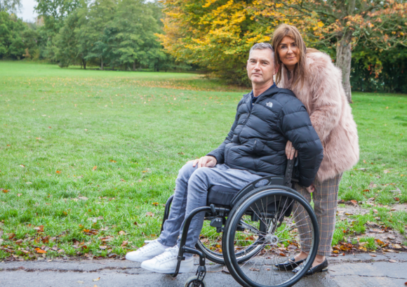 Terry, a wheelchair user, and his partner. Read on for his 2020 impact report story.