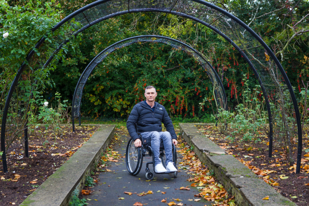 Terry, a wheelchair user in a park. Read on for his 2020 impact report story.