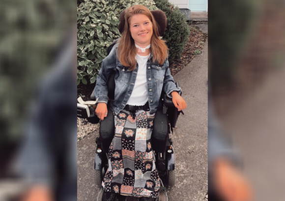 Bel, a young powerchair user with a high level spinal cord injury