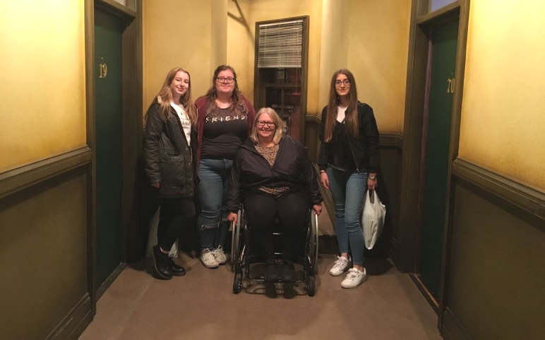 Caroline using her wheelchair to get out of the house.