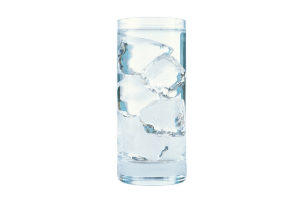 A glass of ice water against a white background