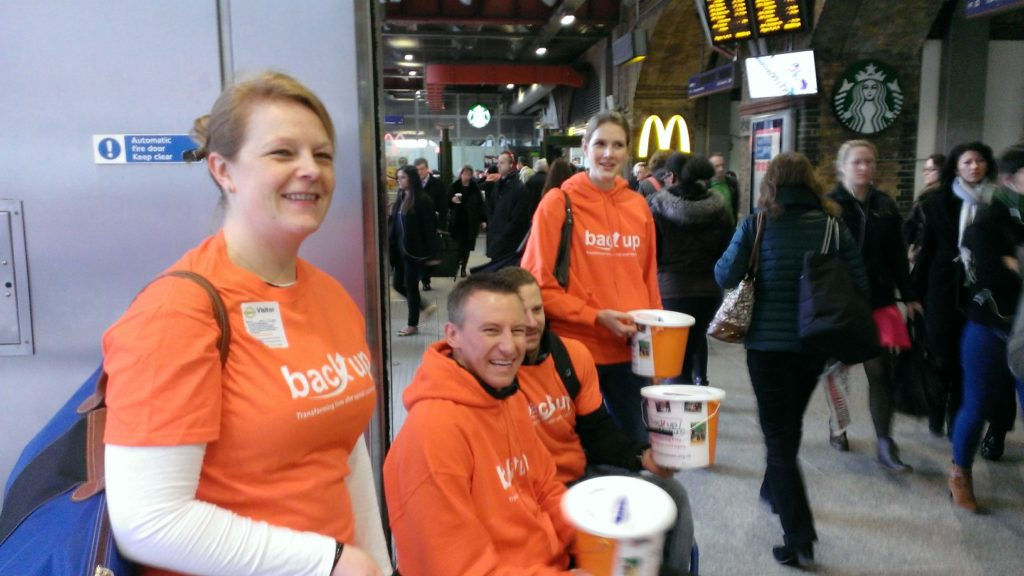 Back Up bucket collectors at a train station