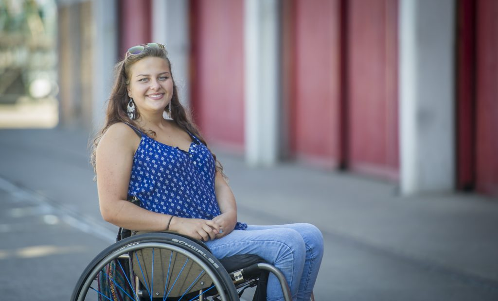 Portrait photo of a young wheelchair skills trainer