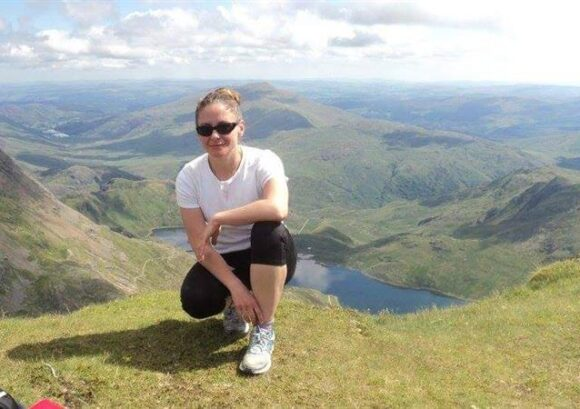 Anita on a mountainside. Anita recently did our Spinal Circuit challenge.