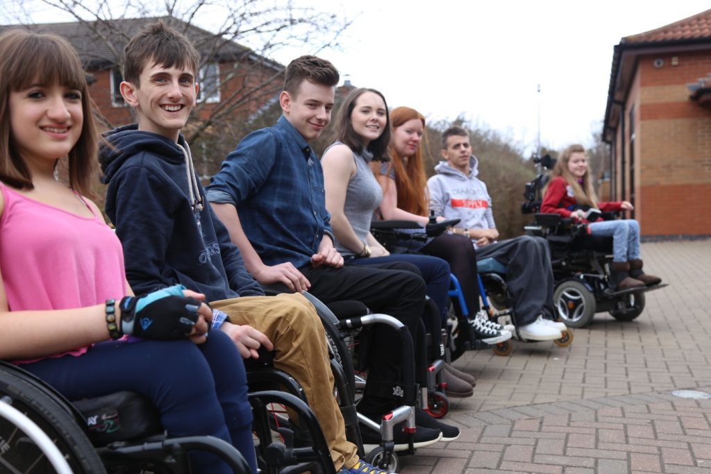 Group of young wheelchair users on a training weekend