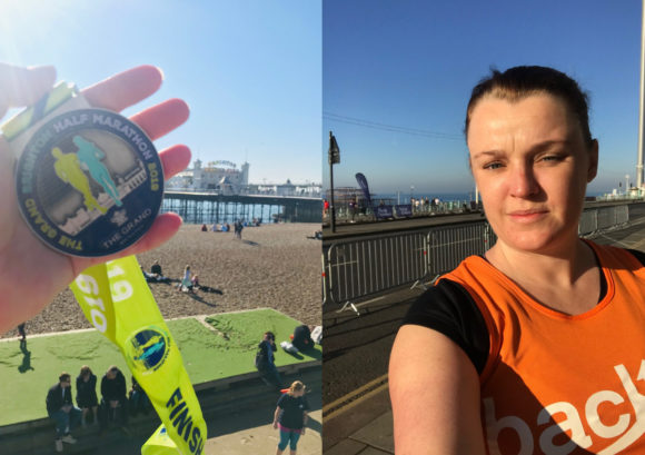 Lisa and her finishers medal at the Brighton half marathon