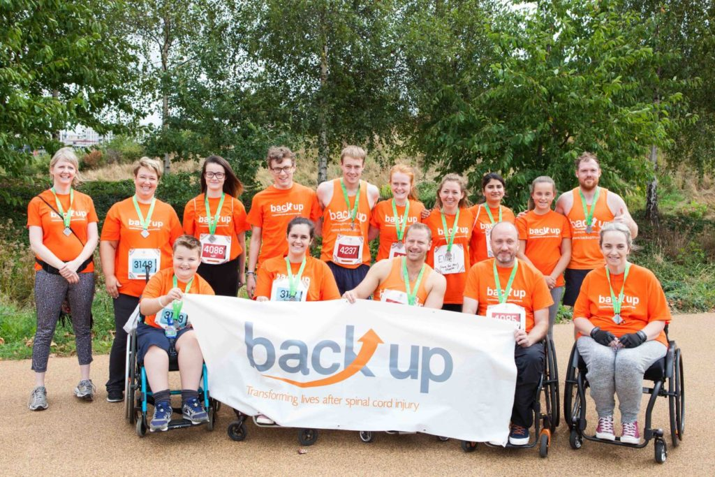 Group of Back Up fundraisers with a big Back Up banner
