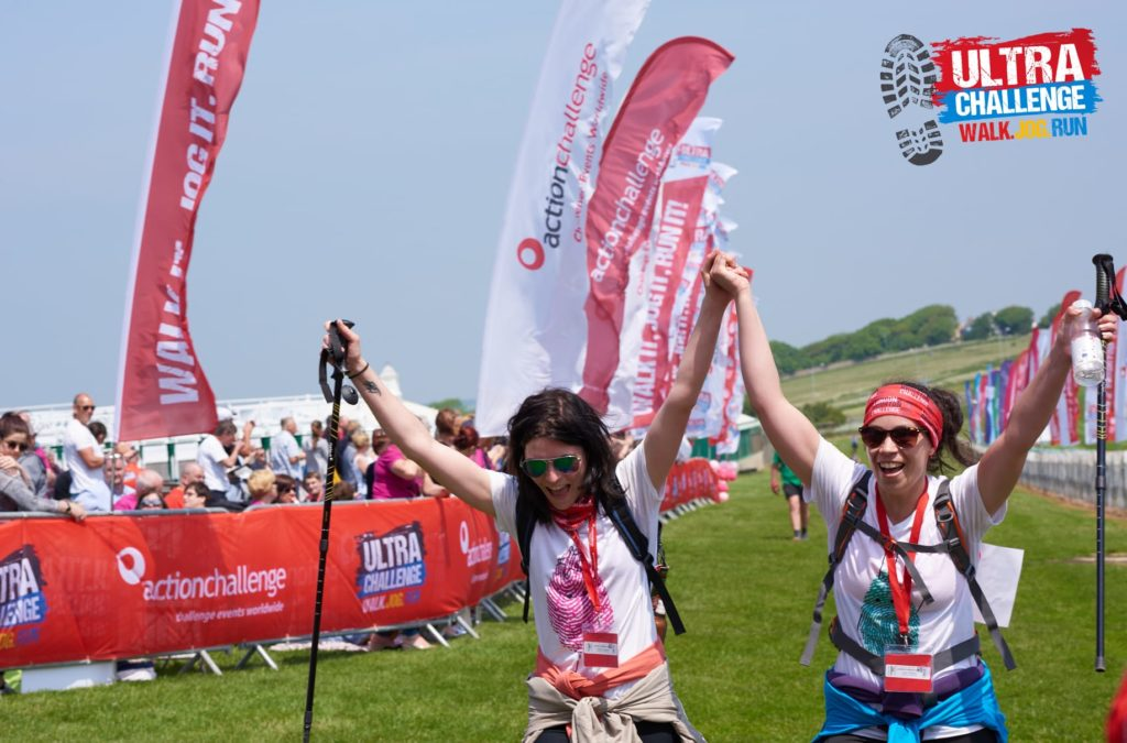 Two friends celebrate at the ultra challenge finish line