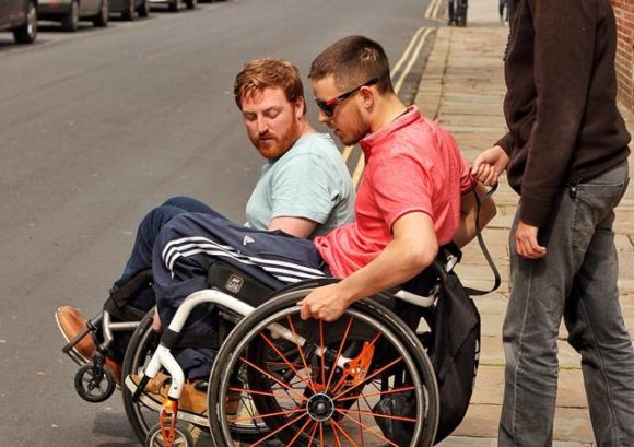 Wheelchair user going down a kerb