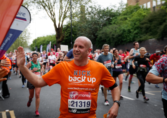 A runner enjoying a one of Back Up's running challenge events