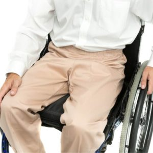wheelchair user wearing stone coloured chinos
